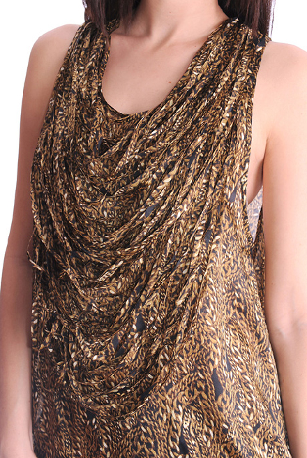 I find this top quite interesting as it is longer at the back and features finely laser cut strands of gold chain fabric to create a necklace effect. It's also 100% silk.
